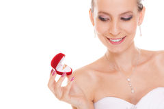 Excited bride woman opening engagement ring box. Stock Images