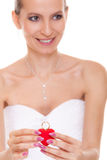 Excited bride woman showing engagement ring box. Stock Image