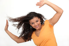Excited brunette. With her arms raised in the air Stock Images