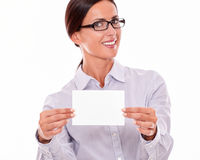 Excited brunette businesswoman with copy space. Happy brunette businesswoman with glasses, wearing her long hair tied back, and a button down shirt, looking Royalty Free Stock Photography