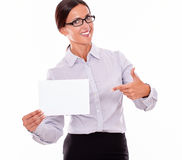 Excited brunette businesswoman with a signboard. Excited brunette businesswoman with glasses, wearing her long hair tied back, and a button down shirt, holding a Royalty Free Stock Photo