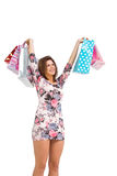 Excited brunette holding up shopping bags Stock Image