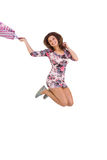 Excited brunette jumping while holding shopping bag Stock Images
