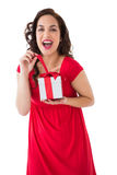 Excited brunette opening a christmas gift Royalty Free Stock Photos