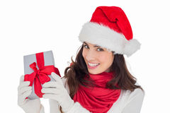 Excited brunette in santa hat showing gift Stock Images