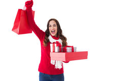 Excited brunette showing christmas gifts Royalty Free Stock Photo