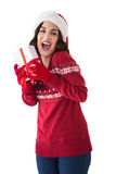 Excited brunette showing christmas present Stock Photos