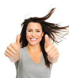 Excited brunette with thumbs up Stock Photo