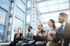 Excited business audience stock image