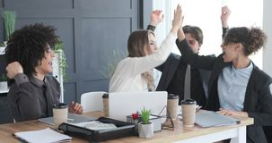 Excited business team celebrating online success. Excited business colleagues cheering and celebrating online success at office stock footage