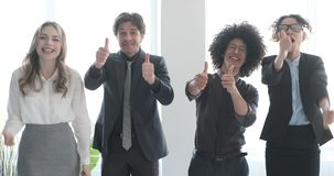 Successful business team gesturing thumbs up. Excited business colleagues gesturing thumbs up and celebrating victory stock video