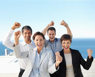 Excited business colleagues with their ha Royalty Free Stock Images