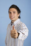Excited business man give thumb up Stock Photos