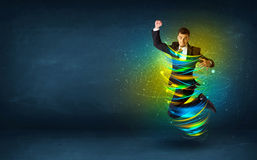 Excited business man jumping with energy colourful lines. Around him Royalty Free Stock Photo