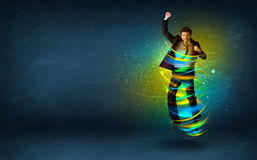 Excited business man jumping with energy colourful lines. Around him Royalty Free Stock Images