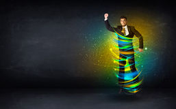 Excited business man jumping with energy colourful lines Stock Images