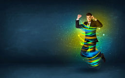 Excited business man jumping with energy colourful lines. Around him Stock Image