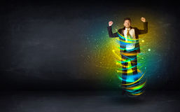 Excited business man jumping with energy colourful lines Royalty Free Stock Photo