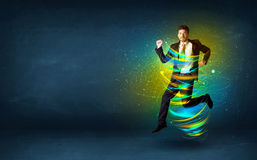 Excited business man jumping with energy colourful lines. Around him Stock Photography