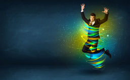 Excited business man jumping with energy colourful lines. Around him Stock Photos