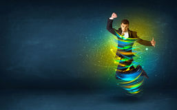 Excited business man jumping with energy colourful lines. Around him Stock Photo