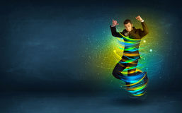 Excited business man jumping with energy colourful lines Royalty Free Stock Image