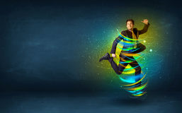 Excited business man jumping with energy colourful lines Stock Photo