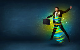 Excited business man jumping with energy colourful lines Stock Photography