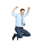 Excited business man jumping in joy over white Stock Images