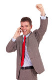 Excited business man on the phone Stock Photography