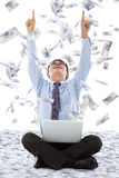Excited business man raise hands with money rain Royalty Free Stock Photography