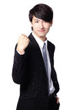 Excited business man showing his fist. Excited handsome business man with arms raised and showing his fist isolated on white background, mode is a asian people Royalty Free Stock Image