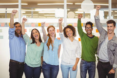 Excited business people with arm raised Royalty Free Stock Photography