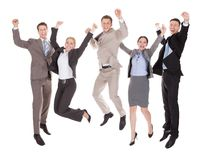 Excited business people jumping over white background Royalty Free Stock Photo