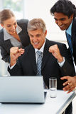 Excited business team on an achievement Stock Photos