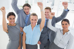 Excited business team cheering at camera Royalty Free Stock Photos
