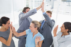 Excited business team cheering Royalty Free Stock Photography