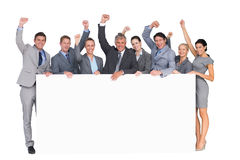Excited business team holding poster Stock Photography