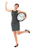 Excited business woman with a clock Stock Image