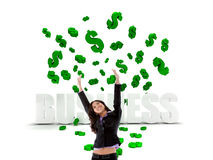 Excited business woman in a dollar's rain Stock Photography