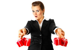 Excited business woman holding presents in hands Stock Photo