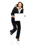 Excited business woman holding sign. Business woman laughing excited holding a blank sign.   Isolated on a white background Stock Photography
