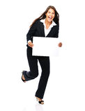 Excited business woman holding sign. Business woman laughing excited holding a blank sign.   Isolated on a white background Royalty Free Stock Images