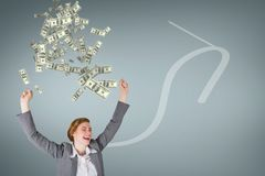 Excited business woman with money rain against blue background with arrow Stock Photography