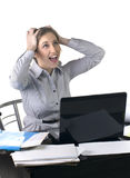 Excited business woman at office with laptop Royalty Free Stock Photos