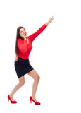 Excited business Woman pointing. Business woman wearing red pointing sideways is excited isolated on white background Royalty Free Stock Image