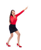 Excited business Woman pointing. Business woman wearing red pointing sideways is excited isolated on white background Stock Photography