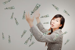Excited Business woman try to catching money Royalty Free Stock Photos