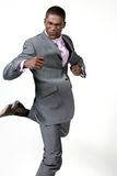 Excited businessman. Businessman strikes a energetic pose Royalty Free Stock Photo