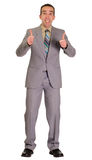 Excited Businessman. Full body view of an excited businessman giving two thumbs up, isolated against a white background Royalty Free Stock Image